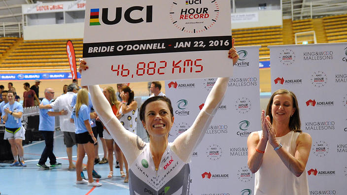 Australian Bridie O'Donnell (C) reacts after breaking the cycling world hour distance record for women riders in Adelaide on January 22, 2016. AFP PHOTO / David Mariuz -- IMAGE RESTRICTED TO EDITORIAL USE - STRICTLY NO COMMERCIAL USE / AFP / DAVID MARIUZ (Photo credit should read DAVID MARIUZ/AFP/Getty Images)