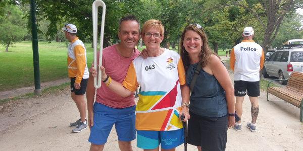 Carol Cooke carries Queen's Baton