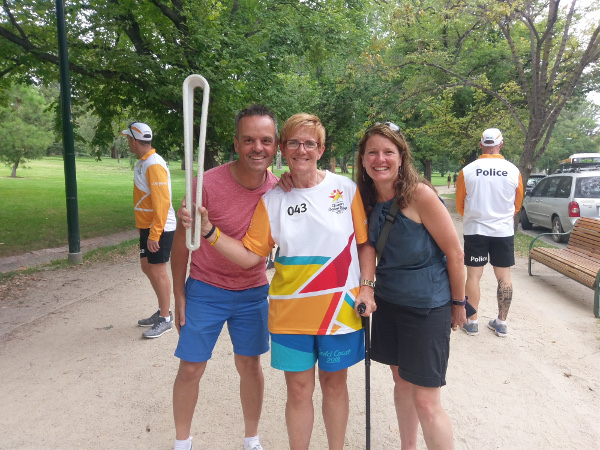 Carol Cooke carries Queen's Baton
